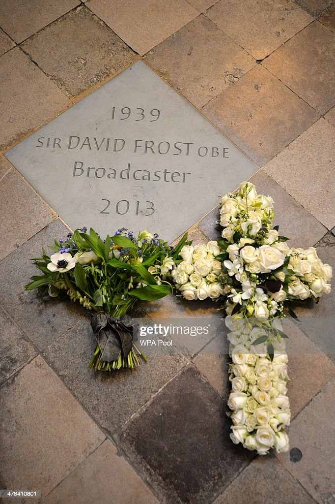 Flowers lie next to a memorial stone for British broadcaster David Frost following a service at Westminster Abbey on March 13, 2014 in London, England.
