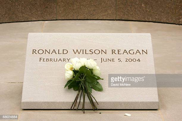 Flowers lie on grave marker of US President Ronald Reagan on the oneyear anniversary of his death at the Ronald Reagan Presidential Library and...