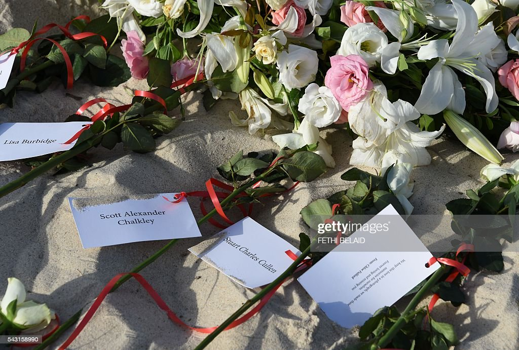 Flowers lie on the beach on June 26, 2016, during a ceremony attended by British and Tunisian officials in memory of those killed a year ago by a jihadist gunman in front of the Riu Imperial Marhaba Hotel in Port el Kantaoui, on the outskirts of Sousse south of the capital Tunis. Tourists fled in horror on June 26, 2015 as a Tunisian gunman pulled a Kalashnikov rifle from inside a furled beach umbrella and went on a shooting spree outside the five-star hotel. 30 Britons were among 38 foreign holidaymakers killed in the attack. / AFP / FETHI