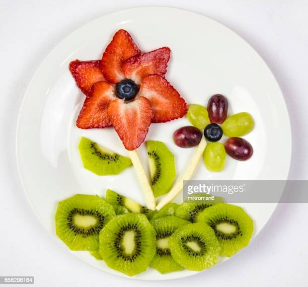 Flowers made with fresh fruits. Fruit Art Recipe. Food art creative concepts.