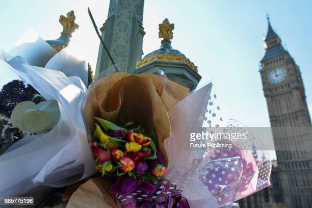Flowers on Westminster Bridge and in Parliament Square as tributes to victims of the Westminster Bridge terror attack seen on April 07 2017 in London...