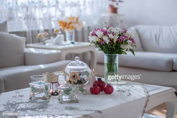 Flowers on white table in room