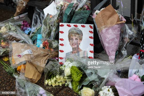 Flowers photographs and messages sit outside an entrance gate to Kensington Palace ahead of the 20th anniversary of the death of Diana Princess of...