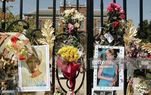 Flowers photographs and tributes are placed in memory of Princess Diana Princess of Wales on the gates of Kensington Palace on 31 August 2005 in...