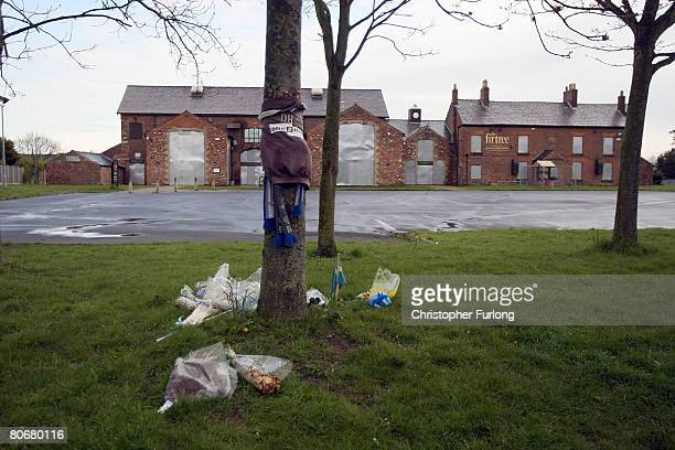 Flowers remain outside the now closed Fir Tree pub following 12 arrests in connection with murder of 11yearold schoolboy Rhys Jones April 15 2008 in...