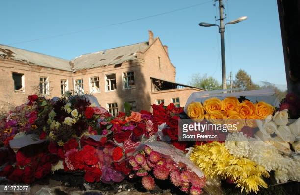 Flowers sit at School No 1 to form a memorial to the terror victims September 8 2004 in Beslan southern Russia Approximately 355 children and adults...