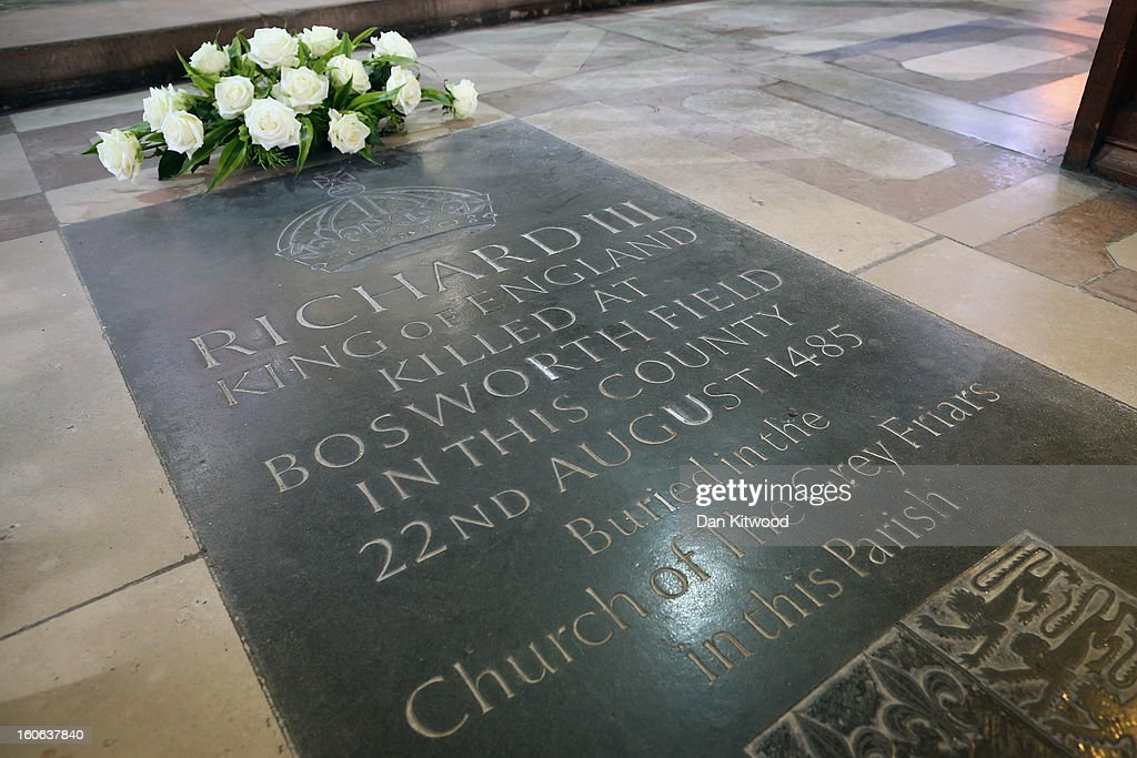 Flowers sit on a memorial stone marking the death of King Richard III inside Leicester Catherdral, close to where the body of Richard III was discovered, on February 4, 2013 in Leicester, England. The University of Leicester has been carrying out scientific investigations on remains found in a car park to find out whether they are those of King Richard III since last September, when the skeleton was discovered in the foundations of Greyfriars Church, Leicester. King's Richard III's remains are to be re-interred at Leicester Catherdral.