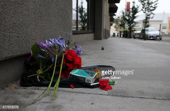 Flowers sit on the ground at the scene of a balcony collapse at an apartment building near UC Berkeley on June 16 2015 in Berkeley California 5...
