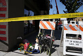 Flowers sit on the ground at the scene of a balcony collapse at an apartment building near UC Berkeley on June 16 2015 in Berkeley California 6...