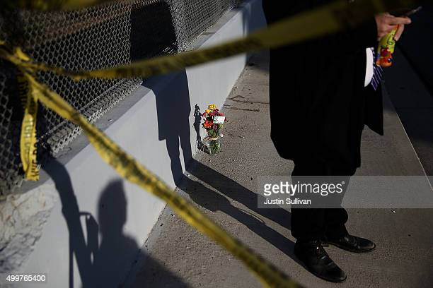 Flowers sit on the sidewalk on Waterman Avenue near the Inland Regional Center on December 3 2015 in San Bernardino California Police continue to...