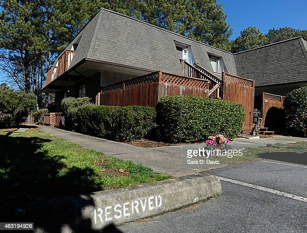 Flowers sit outside the apartments of University of North Carolina dentistry student Deah Shaddy Barakat his new wife Yusor Mohammad and her sister...