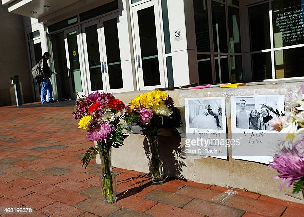 Flowers sit outside the University of North Carolina School of Dentistry in recognition of dentistry student Deah Shaddy Barakat his new wife Yusor...