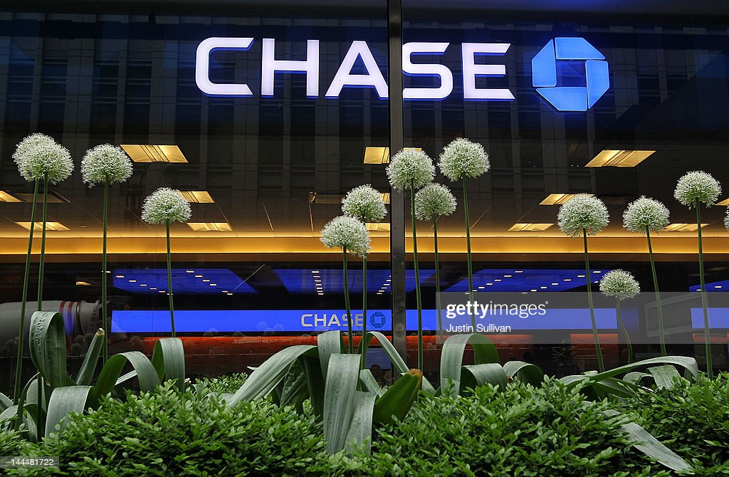 Flowers stand in front of a Chase sign at a bank branch inside the JPMorgan Chase headquarters on May 14, 2012 in New York City. Following a $2 billion trading blunder, JPMorgan Chase's chief investment officer Ina Drew retired and will be succeeded by Matt Zames, an executive from JPMorgan's investment bank. At least two others are also being held accountable for the mistake.