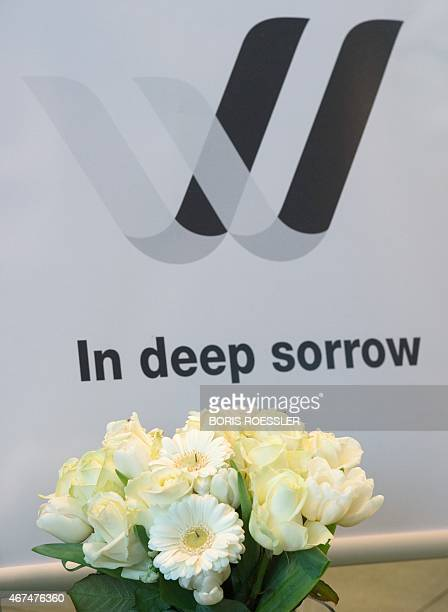 Flowers stand in front of the logo of Lufthansa subsidiary Germanwings with the lettering 'In deep sorrow' at the Lufthansa Aviation Center in...