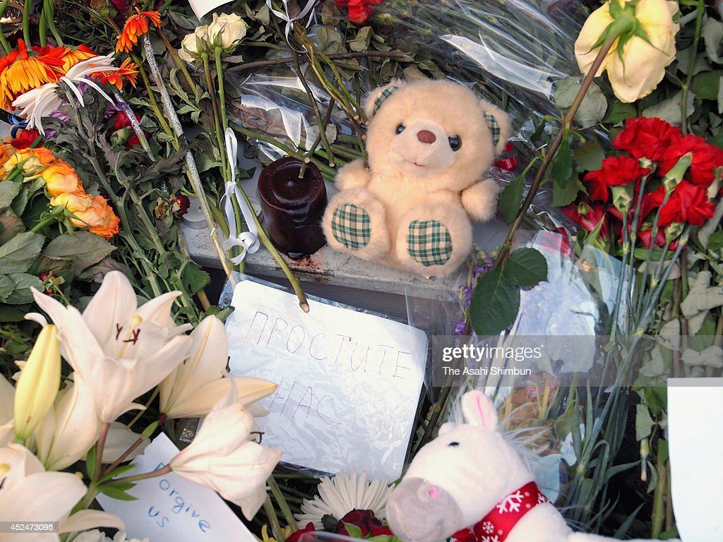 Flowers, stuffed toys and a message card in Russian saying 'Forgive us,' dedicated to those lost in the shooting down of Malaysia Airlines flight MH17, are seen in front of the Dutch Embassy on July 20, 2014 in Moscow, Russia. Malaysia Airlines flight MH17 travelling from Amsterdam to Kuala Lumpur crashed yesterday on the Ukraine/Russia border near the town of Shaktersk. The Boeing 777 was carrying 298 people including crew members, the majority of the passengers being Dutch nationals, believed to be at least 173, 44 Malaysians, 27 Australians, 12 Indonesians and 9 Britons.