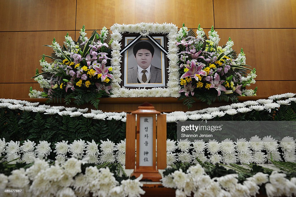 Flowers surround a memorial for Chung Cha Ung at a funeral home on April 18, 2014 in Ansan, South Korea. Chung, a second year student from Danwon High School, lost his life when a ferry carrying 477 passengers on board, including 325 students and 15 teachers of Danwon High School on a school trip, capsized off of Jindo Island in South Korea on April 16, 2014. According to his uncle, one of the survivors reported that Chung gave his life vest to another.