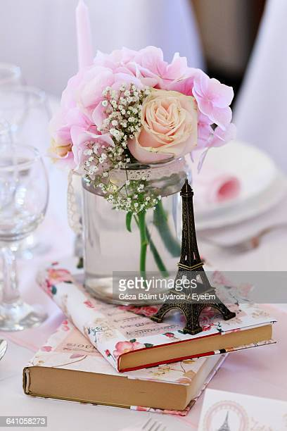 Flowers Vase And Replica Eiffel Tower On Dinning Table During Wedding Ceremony