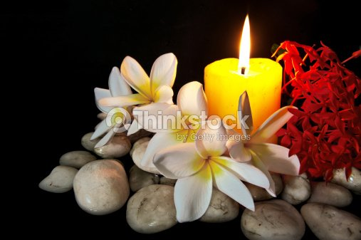 Flowers with candle and white rock for spa stock photo thinkstock flowers with candle and white rock for spa stock photo mightylinksfo