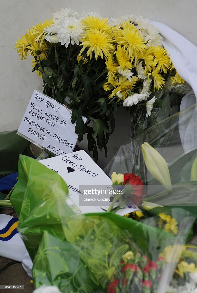 Flowers with cards are left at the Billy Bremner statue outside Elland Road football ground in memory of former player Leeds United Gary Speed on November 28, 2011 in Leeds, England. Wales Manager Gary Speed, 42, was found dead on November 27, 2011 in Cheshire, England.