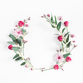 Flowers composition. Wreath made of various pink flowers and eucalyptus branches on white background. Flat lay, top view, copy space, square