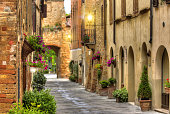 Flowery streets on a spring day in a small old village Pienza, Tuscany.