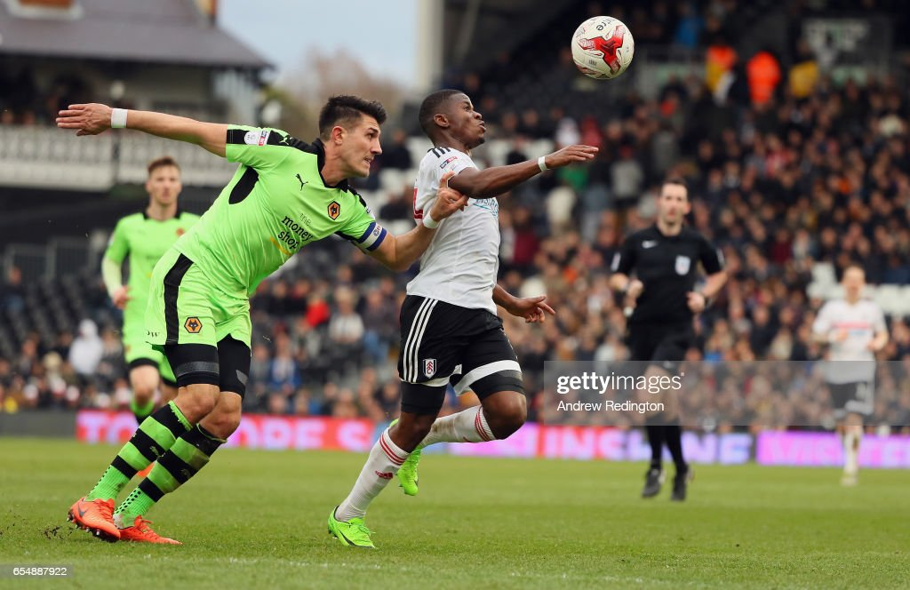 Floyd Ayité of Fulham is tackled by Danny Batth of Wolverhampton Wanderers during the Sky Bet Championship match between Fulham and Wolverhampton Wanderers at Craven Cottage on March 18, 2017 in London, England.