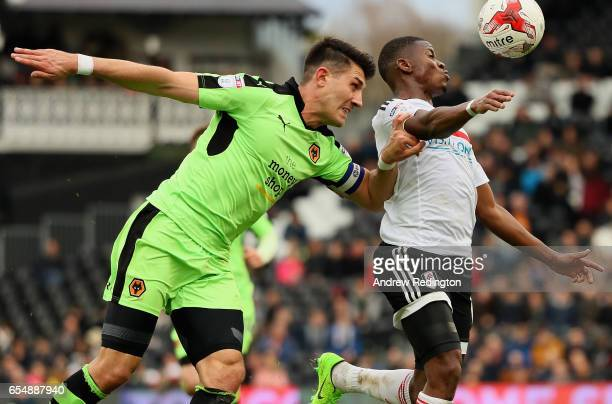 Floyd Ayité of Fulham is tackled by Danny Batth of Wolverhampton Wanderers during the Sky Bet Championship match between Fulham and Wolverhampton...