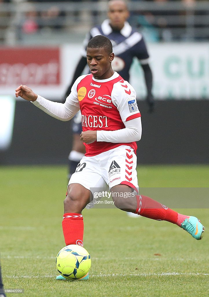 <a gi-track='captionPersonalityLinkClicked' href=/galleries/search?phrase=Floyd+Ayite&family=editorial&specificpeople=5969808 ng-click='$event.stopPropagation()'>Floyd Ayite</a> of Reims in action during the French Ligue 1 match between Stade de Reims and Girondins de Bordeaux at the Stade Auguste Delaune on December 9, 2012 in Reims, France.