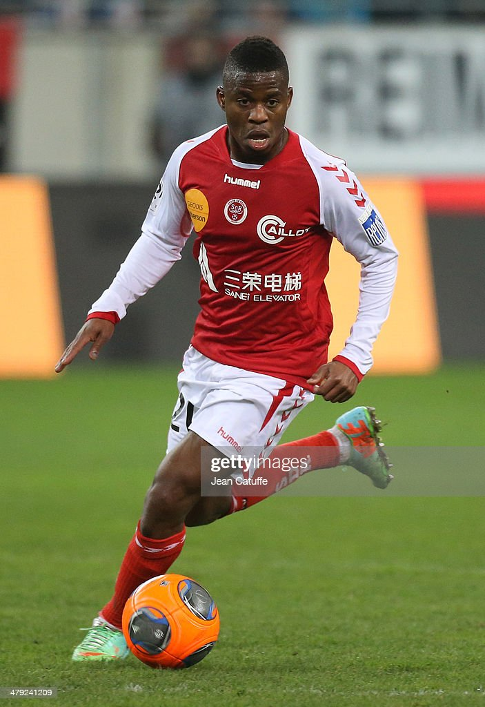 <a gi-track='captionPersonalityLinkClicked' href=/galleries/search?phrase=Floyd+Ayite&family=editorial&specificpeople=5969808 ng-click='$event.stopPropagation()'>Floyd Ayite</a> of Stade de Reims in action during the french Ligue 1 match between Stade de Reims and Olympique de Marseille at the Stade Auguste Delaune stadium on March 14, 2014 in Reims, France.