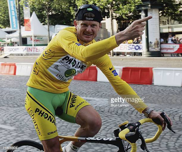 JULY 22 Floyd Landis of the USA and Phonak celebrates winning the 93rd Tour de France on July 23 2006 in Paris France