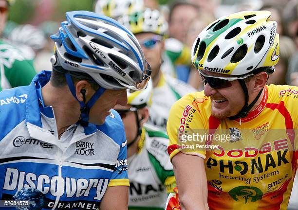 Floyd Landis of the USA of Phonak Hearing Systems chats with former teammate Lance Armstrong of the USA of Discovery Channel Pro Cycling Team at the...