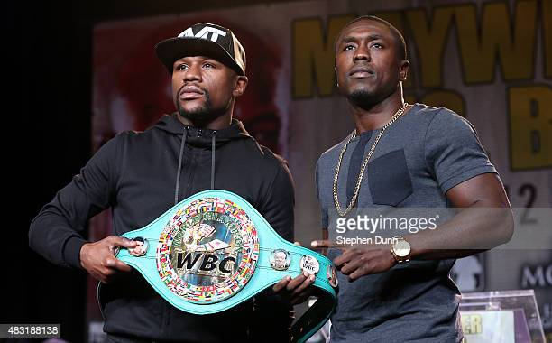 Floyd Mayweather and Andre Berto pose with Mayweather's belt at a press conference ahead of the upcoming fight at JW Marriott Los Angeles at LA LIVE...