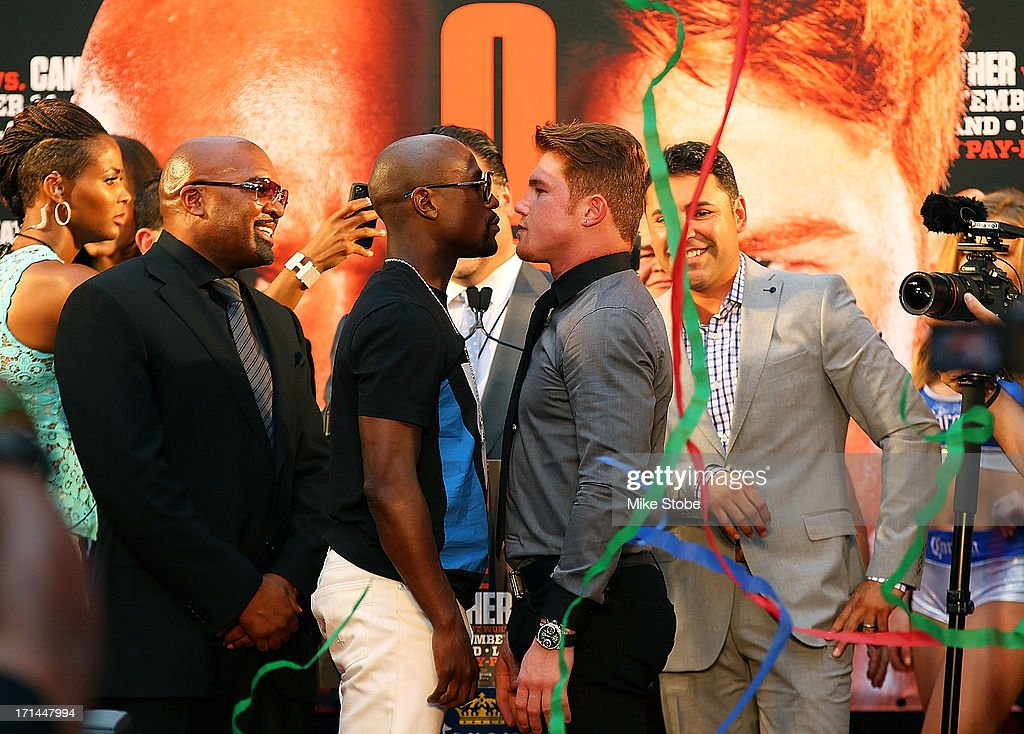 Floyd Mayweather and Canelo Alvarez face-off during a news conference at the Pedestrian Walk in Times Square on June 24, 2013 in New York City. Floyd Mayweather and Canelo Alvarez are scheduled to fight September 14 at the MGM Grand in Las Vegas, Nevada to unifty their junior middleweight world titles.