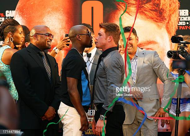 Floyd Mayweather and Canelo Alvarez faceoff during a news conference at the Pedestrian Walk in Times Square on June 24 2013 in New York City Floyd...