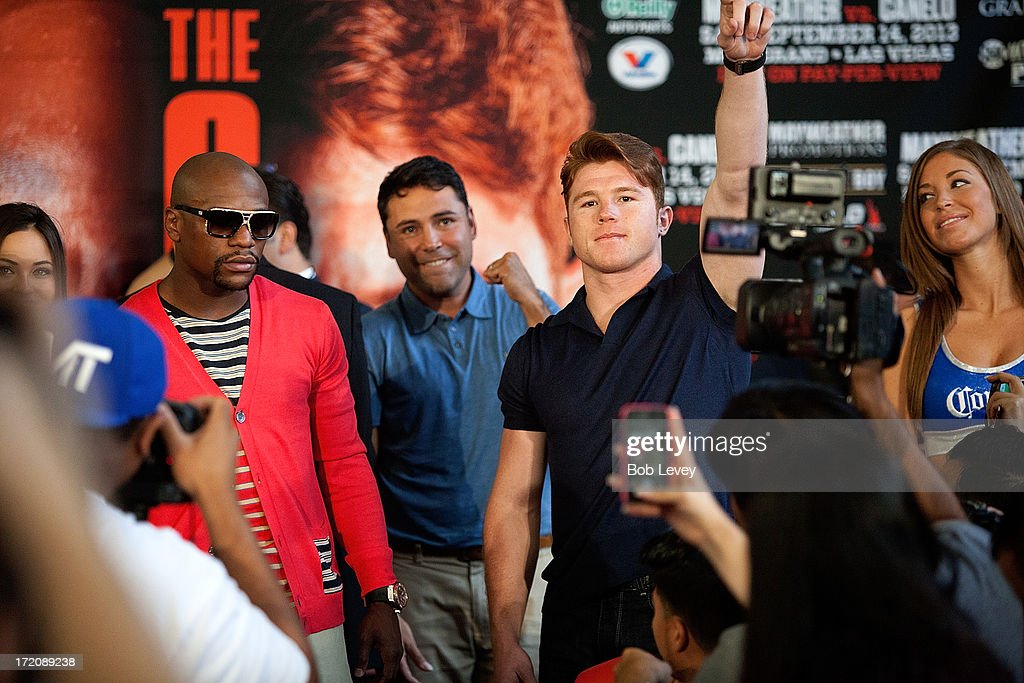 Floyd Mayweather and Canelo Alvarez square off during a press conference to discuss their Super Welterweight World Championship fight July 1, 2013 at Union Station at Minute Maid Park in Houston, Texas. Floyd Mayweather and Canelo Alvarez are scheduled to fight September 14 at the MGM Grand Garden Arena in Las Vegas, Nevada.