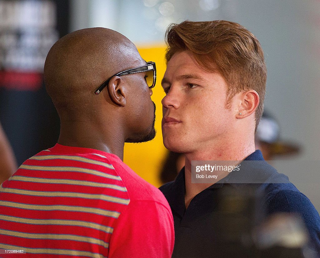Floyd Mayweather and Canelo Alvarez square off during a press conference to discuss their Super Welterweight World Championship July 1, 2013 at Union Station at Minute Maid Park in Houston, Texas. Floyd Mayweather and Canelo Alvarez are scheduled to fight September 14 at the MGM Grand Garden Arena in Las Vegas, Nevada.