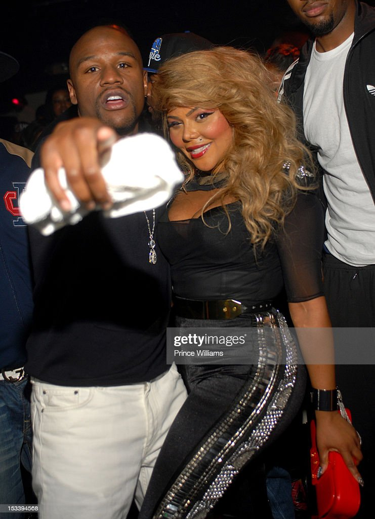 Floyd Mayweather and Lil' Kim attend a party hosted by Gucci and Floyd Mayweather at Life Nightclub on September 29, 2012 in Atlanta, Georgia.