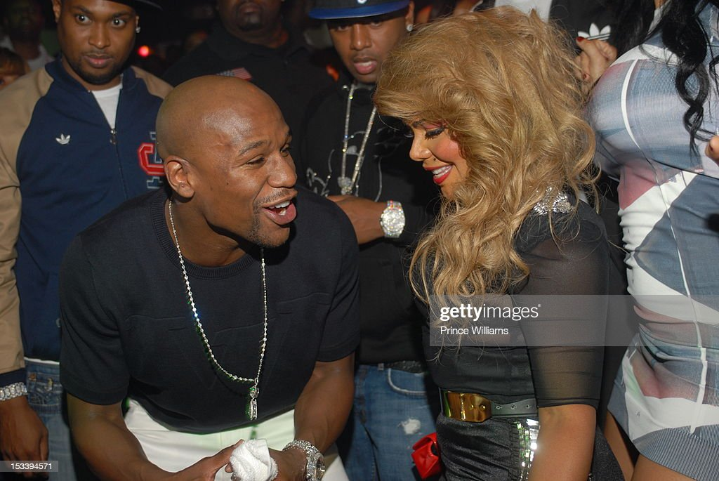 Floyd Mayweather and Lil Kim attend a party hosted by Gucci and Floyd Mayweather at Life Nightclub on September 29, 2012 in Atlanta, Georgia.
