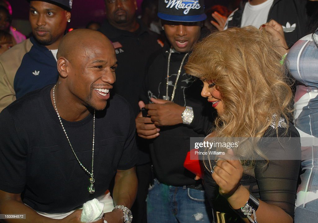 Floyd Mayweather and <a gi-track='captionPersonalityLinkClicked' href=/galleries/search?phrase=Lil%27+Kim&family=editorial&specificpeople=202942 ng-click='$event.stopPropagation()'>Lil' Kim</a> attend a party hosted by Gucci and Floyd Mayweather at Life Nightclub on September 29, 2012 in Atlanta, Georgia.