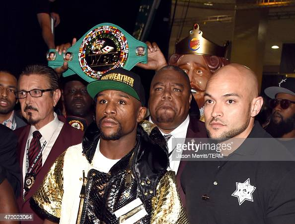 Floyd Mayweather Jr and Burger King walk backstage at 'Mayweather VS Pacquiao' at MGM Grand Garden Arena on May 2 2015 in Las Vegas Nevada