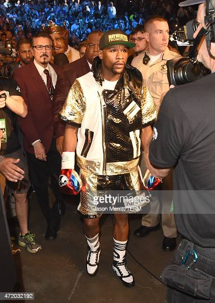 Floyd Mayweather Jr and Burger King walk to the ring at 'Mayweather VS Pacquiao' at MGM Grand Garden Arena on May 2 2015 in Las Vegas Nevada