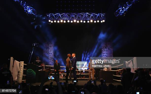 Floyd Mayweather Jr and Conor McGregor come face to face during the Floyd Mayweather Jr v Conor McGregor World Press Tour at SSE Arena on July 14...