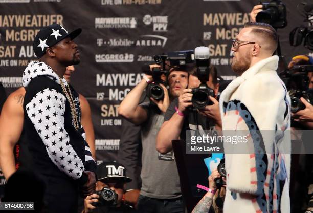 Floyd Mayweather Jr and Conor McGregor face off during the Floyd Mayweather Jr v Conor McGregor World Press Tour event at Barclays Center on July 13...