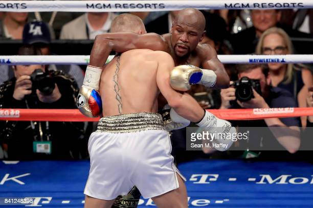 Floyd Mayweather Jr and Conor McGregor hold during their super welterweight boxing match on August 26 2017 at TMobile Arena in Las Vegas Nevada