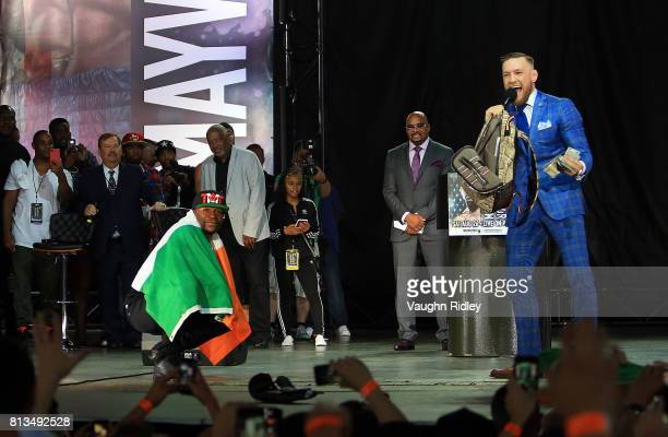 Floyd Mayweather Jr and Conor McGregor on stage during the Floyd Mayweather Jr v Conor McGregor World Press Tour at Budweiser Stage on July 12 2017...