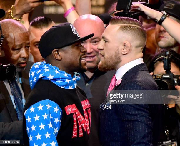 Floyd Mayweather Jr and Conor McGregor stand face to face during the Floyd Mayweather Jr v Conor McGregor World Press Tour at Staples Center on July...