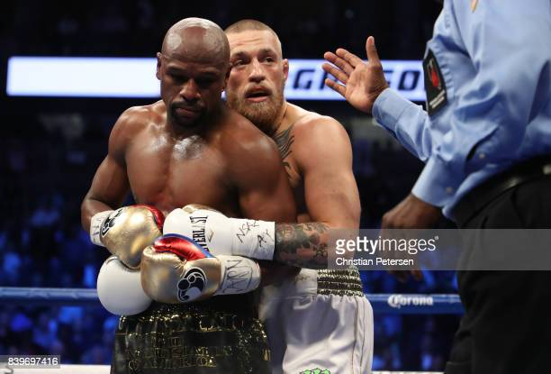 Floyd Mayweather Jr and Conor McGregor tie up during their super welterweight boxing match on August 26 2017 at TMobile Arena in Las Vegas Nevada