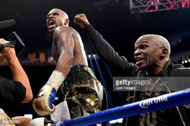 Floyd Mayweather Jr and Floyd Mayweather Sr celebrate after defeating Conor McGregor during their super welterweight boxing match on August 26 2017...