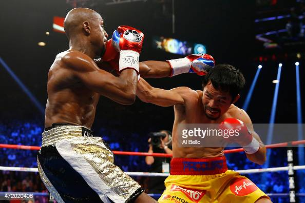 Floyd Mayweather Jr and Manny Pacquiao exchange punches during their welterweight unification championship bout on May 2 2015 at MGM Grand Garden...