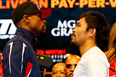 Floyd Mayweather Jr and Manny Pacquiao face off during their official weighin on May 1 2015 at MGM Grand Garden Arena in Las Vegas Nevada The two...